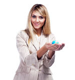 Pretty smiling woman holding a world globe. Business woman Stock Images