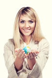 Pretty smiling woman holding a world globe. Business woman Stock Photography