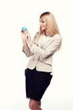 Pretty smiling woman holding a world globe. Business woman Royalty Free Stock Image