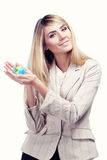 Pretty smiling woman holding a world globe. Business woman Royalty Free Stock Photos