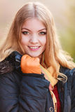 Pretty smiling woman in jacket. Ppretty woman in fall forest park. Gorgeous girl in jacket. Autumn winter fashion Royalty Free Stock Photos