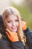 Pretty smiling woman in jacket. Ppretty woman in fall forest park. Gorgeous girl in jacket. Autumn winter fashion Stock Image