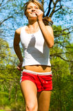Pretty smiling woman jogging Stock Image