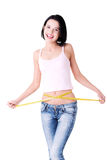 Pretty smiling woman with measurement type Royalty Free Stock Photos