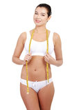 Pretty smiling woman with measurement type Stock Image