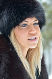 Pretty smiling woman portrait outdoor in winter Stock Image