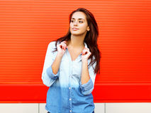 Pretty smiling woman posing near bright colorful wall Stock Images