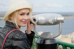 Pretty Smiling Woman Posing at the Telescope Royalty Free Stock Photo