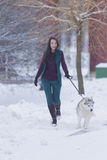 Pretty Smiling Woman Walking with Her Dog Outside. Royalty Free Stock Photography
