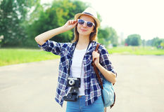 Pretty smiling woman wearing straw hat sunglasses and vintage camera Royalty Free Stock Photo
