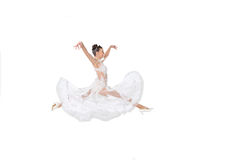 Pretty smiling woman in wedding dress jump isolated on white Stock Photos