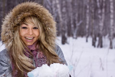 Pretty smiling woman in winter forest Royalty Free Stock Image
