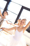Pretty smiling young ballerina in training Stock Photography