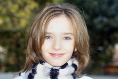 Pretty Smiling Young Girl. Happy little girl with striped scarf smiling Stock Photos