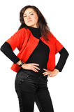 Pretty smiling young girl in red-black clothes Stock Image