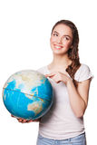 Pretty smiling young lady holding a world globe Royalty Free Stock Photo