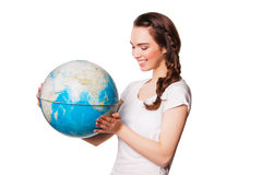 Pretty smiling young lady holding a world globe. isolated on white Royalty Free Stock Images