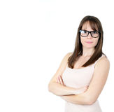 Pretty smiling young woman in black glasses with crossed arms on Royalty Free Stock Photos