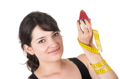 Pretty smiling young woman holding measuring tape Royalty Free Stock Photography