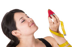Pretty smiling young woman holding measuring tape Royalty Free Stock Photos