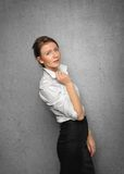 Pretty smiling young woman in office clothes Royalty Free Stock Photos
