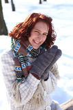 Pretty smiling young woman in a winter park outdoors Stock Images