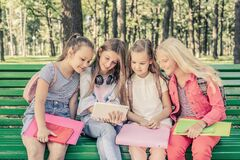 Pretty Smilng Little Girls Sitting Together Stock Image