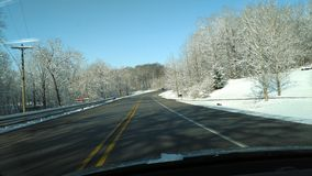 Pretty snow covered trees along state road 26 royalty free stock photography