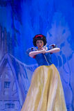 Pretty Snow White. GREEN BAY, WI - FEBRUARY 10: Pretty Snow White in her blue and yellow dress at the Disney Princesses show at the Resch Center on February 10 Royalty Free Stock Photos