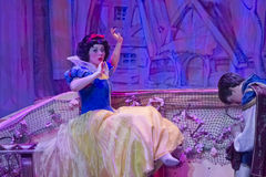 Pretty Snow White awake after Kiss by Prince Royalty Free Stock Images