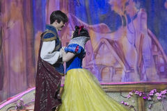 Pretty Snow White dancing with Prince. GREEN BAY, WI - FEBRUARY 10: Pretty Snow White dancing with Prince Charming in her blue & yellow dress at the Disney Stock Photos