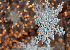 Pretty snowflake decoration in a shop window Royalty Free Stock Images