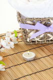 Pretty spa setting. Cotton towel by candle in spa Royalty Free Stock Image