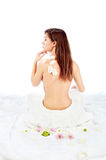 Pretty spa woman. Back of beautiful brunette woman, isolated on white Royalty Free Stock Photo