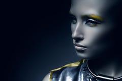Pretty space woman in dark. In studio stock image