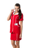 Pretty  spectacled women  doctor  in red dress Royalty Free Stock Images