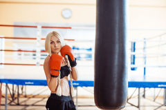 Pretty sport woman with boxing gloves Stock Images