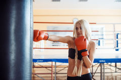 Pretty sport woman with boxing gloves Stock Photos