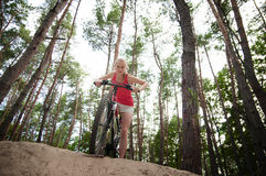 Pretty sportive girl  on a bicycle Royalty Free Stock Photos