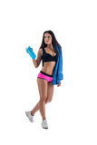 Pretty sportswoman posing with towel and shaker Stock Image