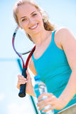 Pretty sportswoman with racket on shoulders Stock Photo