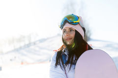 Pretty sportswoman in ski suit. On snow resort Royalty Free Stock Image