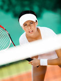 Pretty sportswoman in sportswear playing tennis Stock Photo