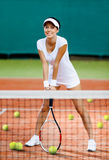 Pretty sportswoman at the tennis court Stock Photo