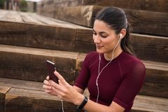 Pretty sporty brunette looking at her phone Royalty Free Stock Images
