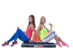Pretty sporty girls posing with gymnastic items Royalty Free Stock Photos