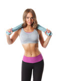 Pretty sporty woman holding a towel after workout Royalty Free Stock Photography