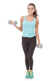 Pretty sporty woman holding weights Stock Images