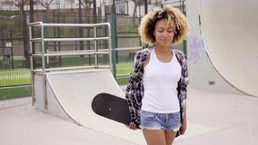 Pretty sporty young woman at a skating rink stock footage