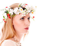 Pretty spring girl with wreath on head. Looking forward on white background Royalty Free Stock Photos